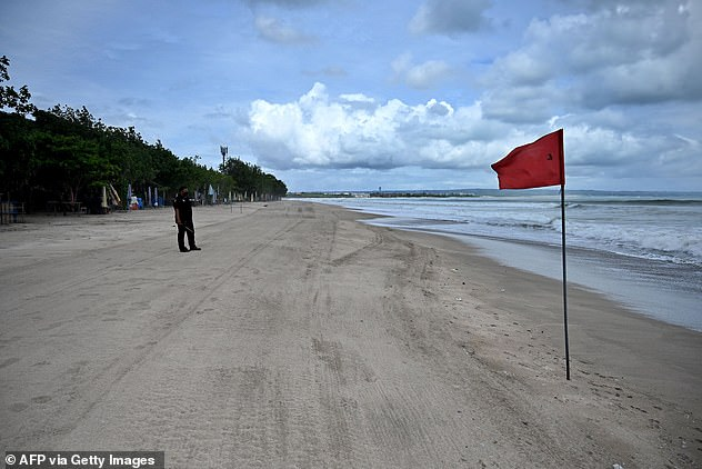 The Indonesian government is reportedly planning for a 'travel bubble' with Australia, China, South Korea and Japan in a desperate bid to boost tourism (pictured: An empty beach in Bali)