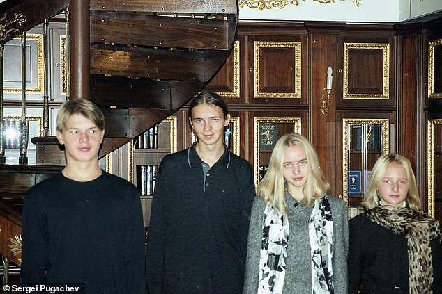 Pictured from left to right: Alexander and Viktor Pugachev and Maria and Ektaterina Putin in the Kremlin library in the early 2000s