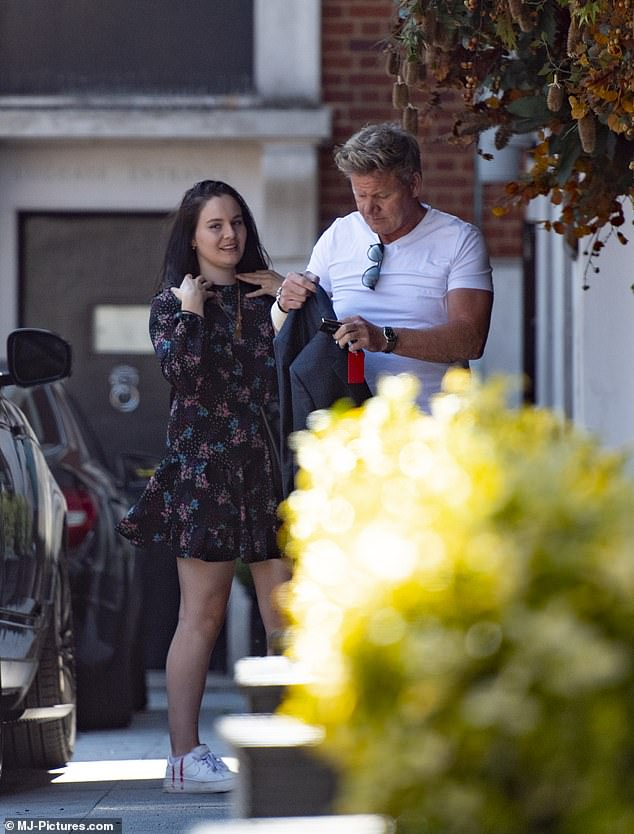 Assistant? He was trailed by his glamorous daughter Holly as he zipped around the capital in the swanky motor to get back to work after his idyllic stay
