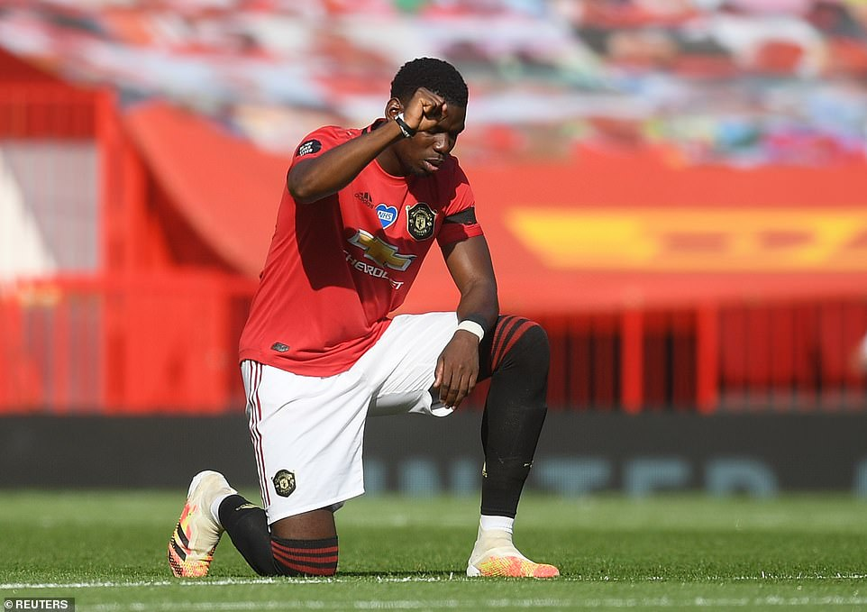 Paul Pogba takes a knee along with team-mates in support of the Black Lives Matter movement before the first whistle