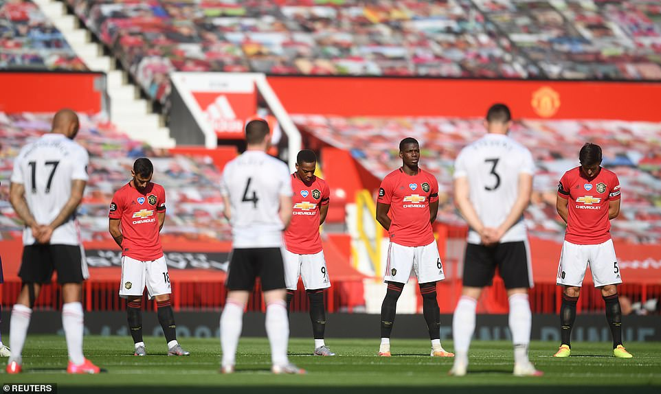 The players observe a minute's silence before the match for the victims of the coronavirus disease across the world