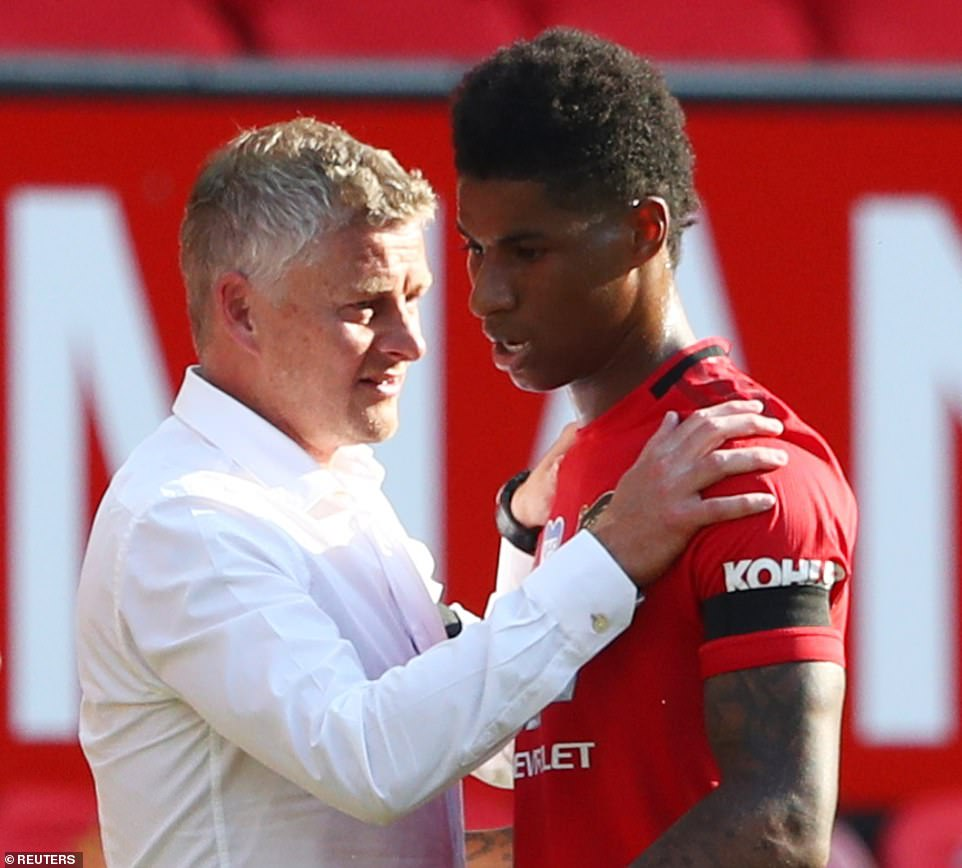 Marcus Rashford receives instructions from Manchester United boss Ole Gunnar Solskjaer during the break in play