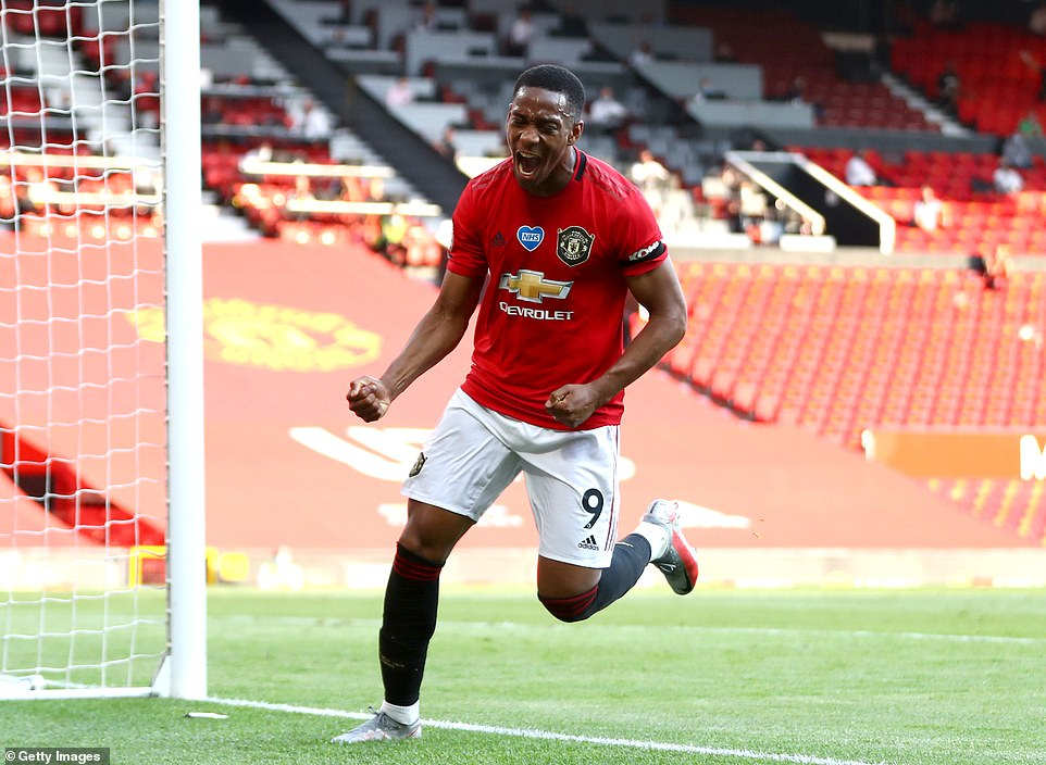 Anthony Martial celebrates after completing the first hat-trick of his career in a comfortable win for Manchester United
