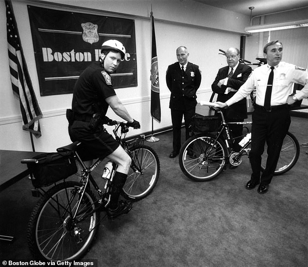 Danilecki, left, poses with a bicycle being considered for police use in April 1993