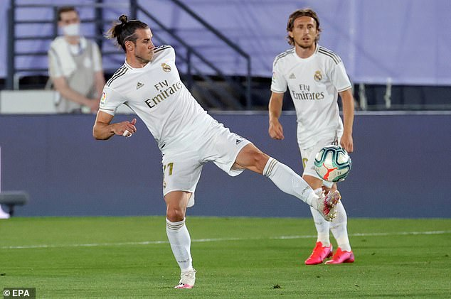 Real Madrid star Gareth Bale controls the ball during the first half of the game against Mallorca