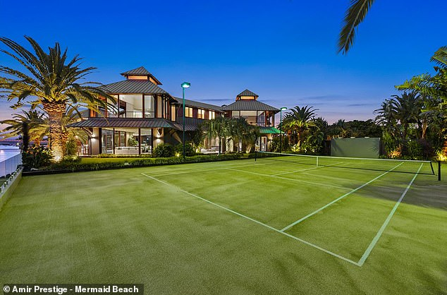 The private tennis court (pictured) which overlooks the Nerang River, where you can boat or ride jet-skis all year round