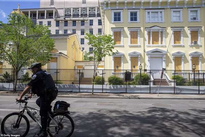 A lone cop cycles through the empty plaza. In Washington DC the National Guard has been called in to guard statues