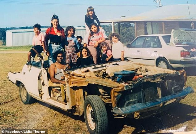 An incoming senator who declared she doesn't identify as Australian experienced racism as an Aboriginal girl growing up in Melbourne. Lidia Thorpe is pictured, second left and standing on a stripped back Ford Falcon Aboriginal mission car, at Lake Tyers, an area where her mother's family were massacred. She is with her cousins and her uncle Michael
