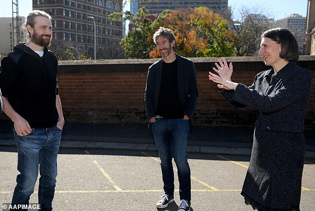 Atlassian, founded by friends Mike Cannon-Brookes (left) and Scott Farquhar (middle) was named co-creator of the government-funded project in 2018
