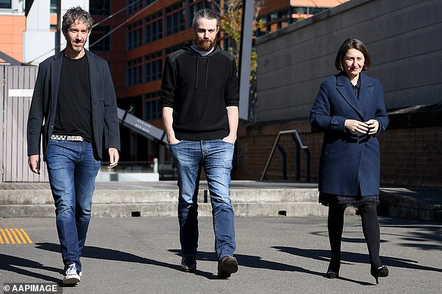 Co-CEO's of Atlassian Scott Farquhar and Mike Cannon-Brookes along with NSW Premier Gladys Berejiklian arrive to a press conference in Sydney on Thursday