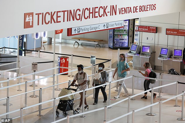 Governor Andrew Cuomo's order to stop visitors from states where cases of the coronavirus have started reaching higher levels may not be enforceable, according to experts. Travelers are pictured boarding flights that originated in Texas, one of the affected states, Wednesday
