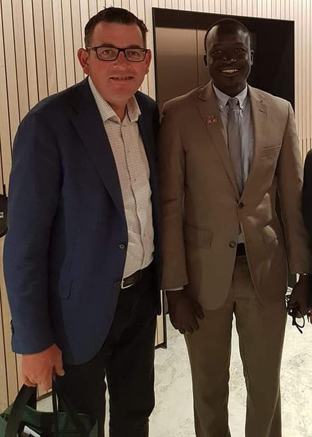 Ring Mayar, the chairman of the South Sudanese Community Association in Victoria, with that state's premier Daniel Andrews, says the government's efforts were just a 'box ticking' exercise
