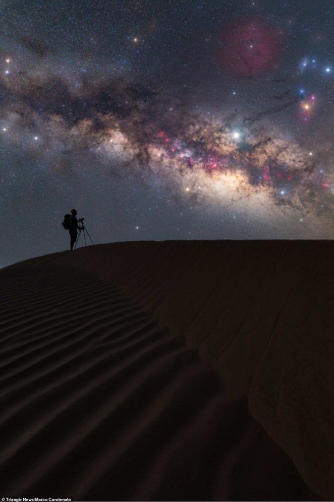 'Alone & Together in the Stardust' by Marco Carotenuto, taken in the Sahara desert, the largest hot desert in the world.Carotenuto said: 'Staying in the middle of nowhere hundreds of miles away from civilisation and with no electricity, cellular network, or water, certainly puts you to the test'