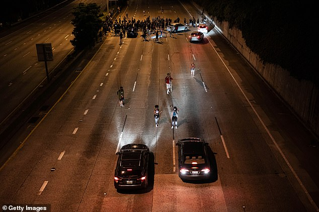 Pictured: Protesters block Interstate 5 after marching from the area known as the Capitol Hill Organized Protest (CHOP) on June 24, 2020 in Seattle, Washington
