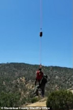 The vicim pictured suspended on a string connected to the helicopter above