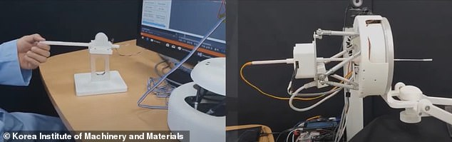 A small joystick sits on the table with a short stick attached to it that acts like the robot's swab, allowing the nurse or doctor to maneuver the robot through the procedure