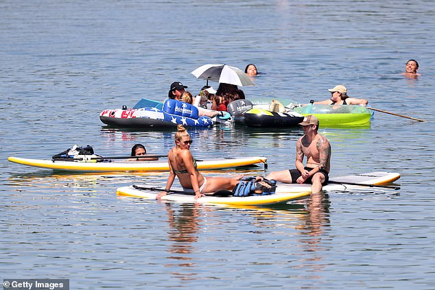 Residents swim, paddle board and kayak in Barton Creek on May 20 in Austin, Texas after the state aggressively started lifting lockdown measures