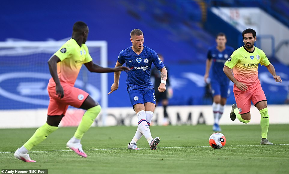Ross Barkley plays a pass during the first-half of the clash against City while being tracked by midfielder Ilkay Gundogan
