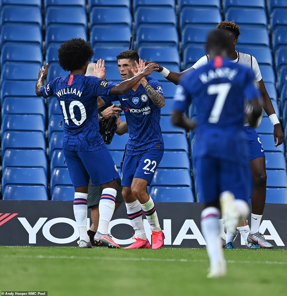 Pulisic celebrates with Willian after scoring the only goal of the first-half in the clash at Stamford Bridge on Thursday night