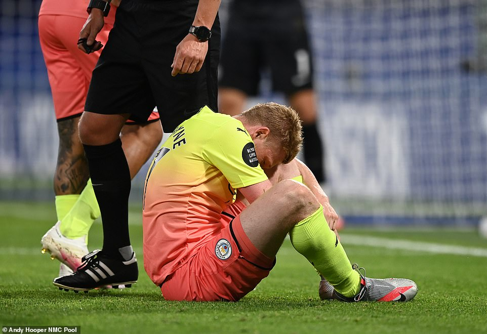 De Bruyne clutches his ankle after being caught with a stud by Chelsea defender Antonio Rudiger in a follow through