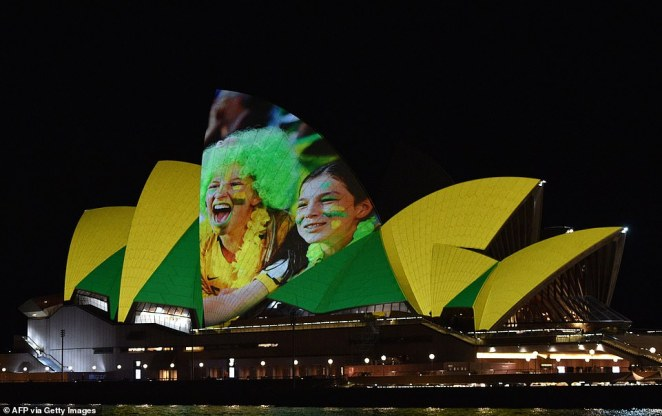 The Sydney Opera House was lit up in green and gold on Thursday to celebrate Australia's joint bid with New Zealand