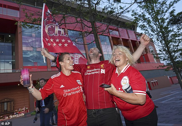 Liverpool fans were pictured celebrating outside Anfield after news of the title was confirmed