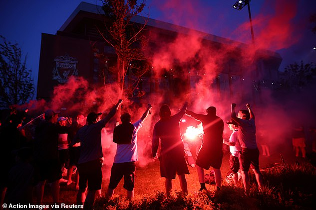 Flares were lit as fans congregated at Anfield to celebrate the club's 19th league title