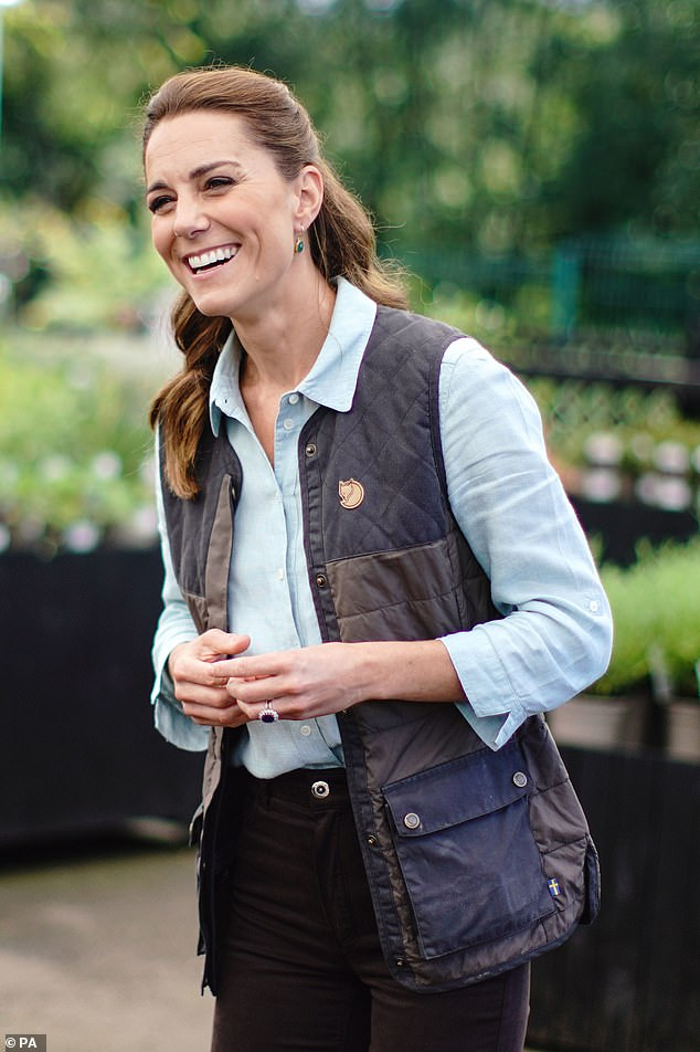 The Duchess of Cambridge chats with staff members at the Fakenham Garden Center in Norfolk on her first public engagement since the Lock