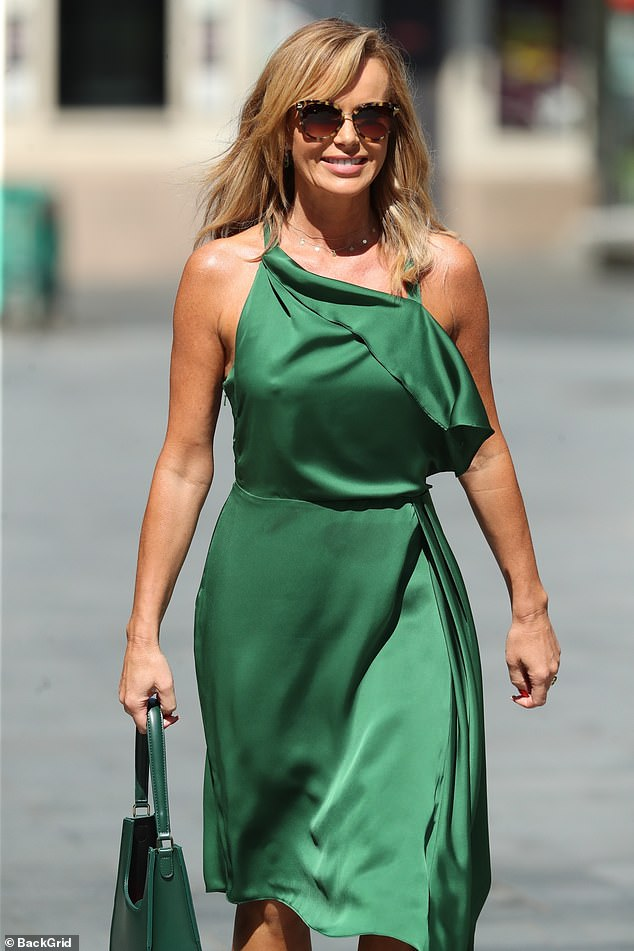 Superb: the glam star, 49, chose a magnificent olive green satin number for her last show of the week, showing her tanned figure as she crossed central London