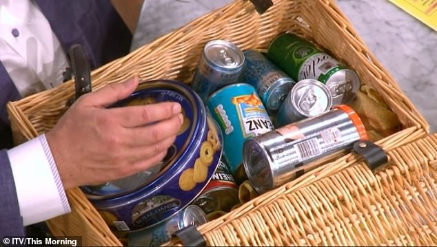 Good haul: In the hamper of gifts offered by Eamonn were a tin of biscuits, canned gin and tonics and baked beans
