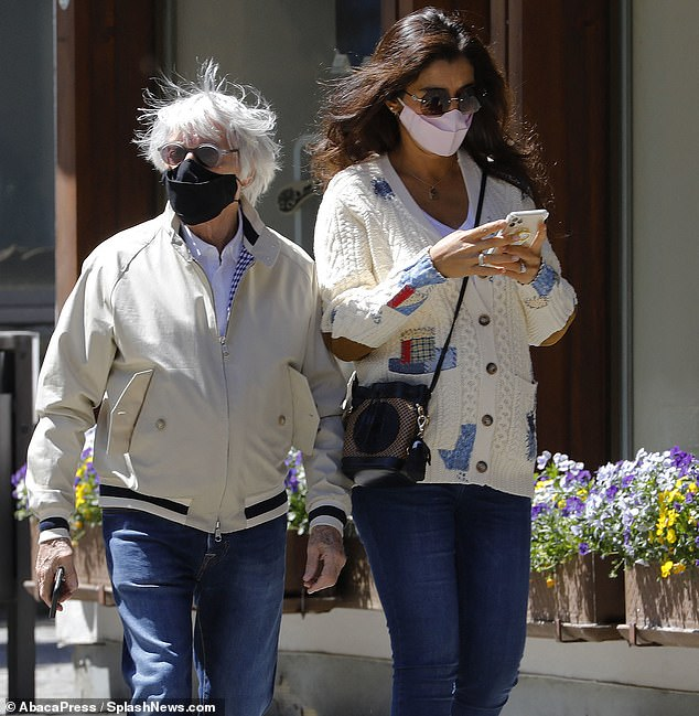 Bernie Ecclestone, 89, with his wife Fabiana Flosi, 44, during a construction visit to their Swiss hotel. F1 Supremo said `` blacks are more racist than whites '' in an interview with CNN