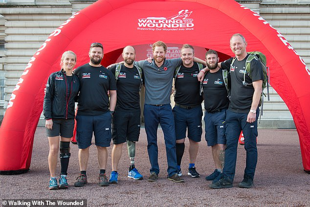 Harry, who has been involved with the charity for several years, referred to it as 'my Walking With The Wounded family' (pictured joined military veterans for a 1,000-mile walk of Britain in 2015 (above))