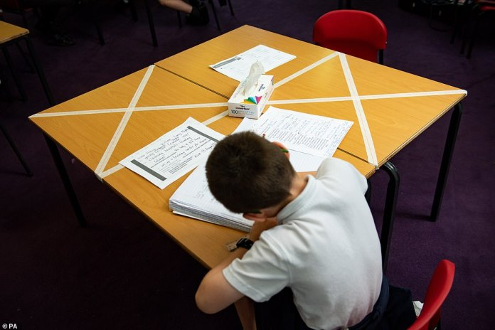 Social distancing measures while a child studies on a marked table at Kempsey Elementary School in Worcester, May 18, 2020