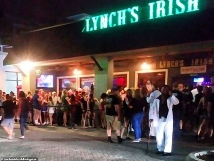 FLORIDA: The Florida Commercial and Professional Regulation Department told bars to immediately stop serving alcohol on their premises on Friday. In the photo, Lynch's Irish Pub in Jacksonville Beach where several people tested positive for the virus after going to the bar