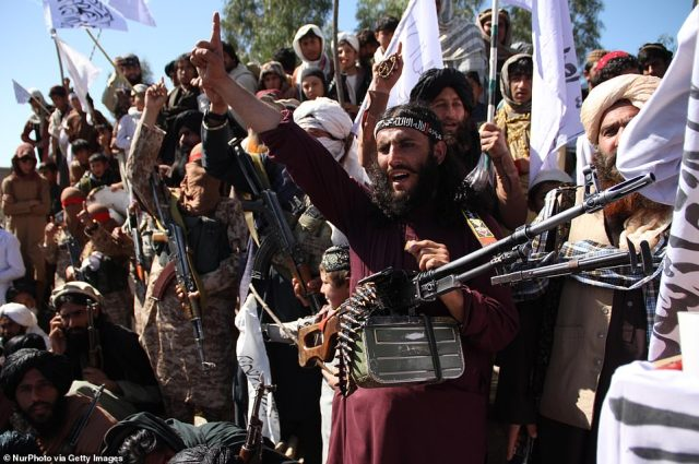 Afghan Taliban fighters and villagers attend a gathering as they celebrate the peace deal signed between US and Taliban in Laghman Province, Alingar district on March 2, 2020