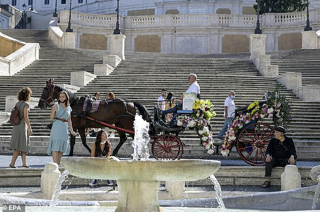 Italy reopened its borders to tourists from Europe at the beginning of the month, three months after their closure as the country entered the closure of the coronavirus. Pictured: people gather around a typical horse-drawn carriage decorated with flowers in Piazza di Spagna in Rome