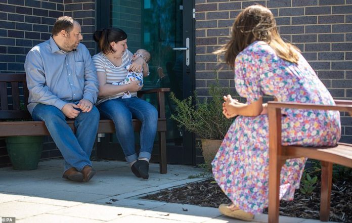 Duchess meets Liam and Lisa Page and baby Connor during her visit to the Norfolk Children's Hospice