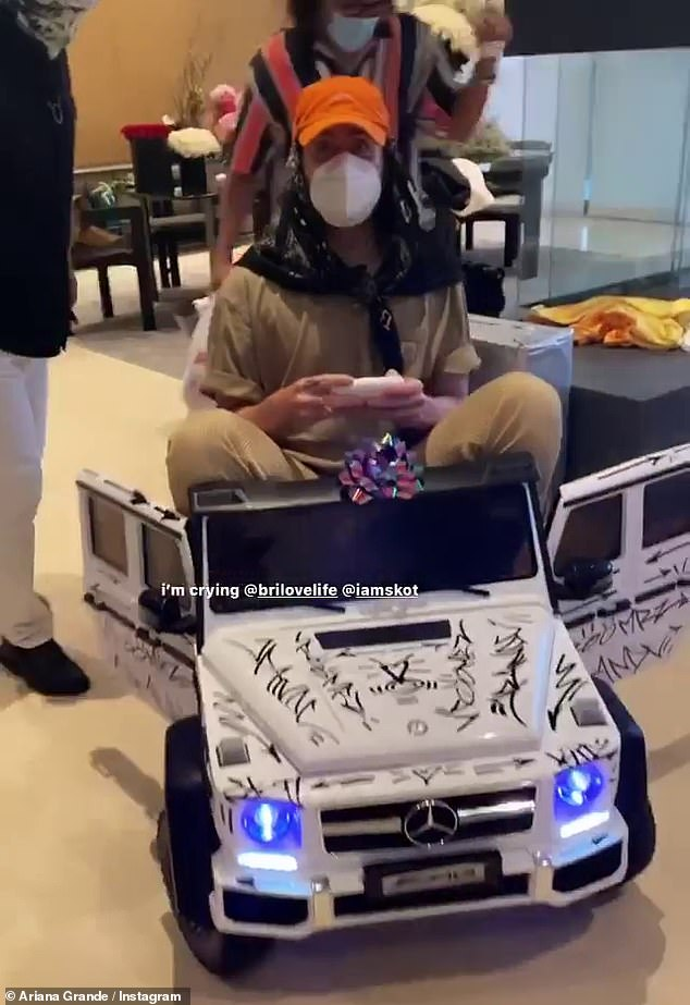 Sweet Wheels: Ariana didn't say much about her birthday gifts, but one gift seemed to be a graffitied Mercedes toy, which a masked friend took for a drive