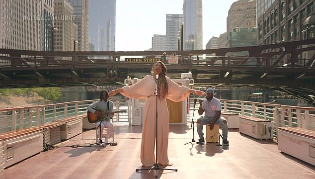 Amazing: Jennifer performed the song with two musicians on the deck of a boat as it slowly floated on the Chicago River