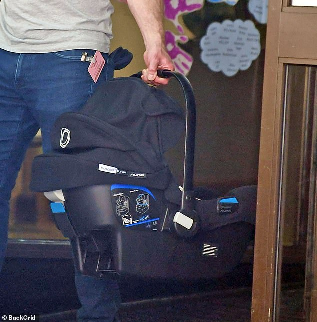 Prepared: Dermot wore a car seat for his newborn son when he arrived at the hospital