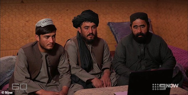 Hazratullah Sardar, 22, (pictured left) andAbdul Sardar, 34 (centre) sit with a tribal elder (right) in Afghanistan as they listen to Dusty Miller's grief-torn apology for their father's death