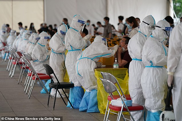 Despite China appears to have largely brought the virus under control, hundreds have been infected in Beijing and cases have emerged in neighbouring Hebei province in recent weeks. Medical workers swab throat of people for nucleic acid testing of COVID-19 in Beijing Sunday