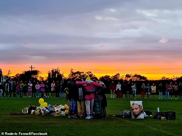 Ms Ferry'sheartbroken family and friends gathered arm-in-arm at sunset on Sunday as part of a memorial to the talented student