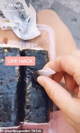 A young woman has demonstrated the 'correct' way to eat sushi with soy sauce