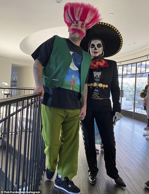 In costume: The last time he appeared on his Instagram was on a Halloween photo, in which he went as Troll and Kris as a sugar skull