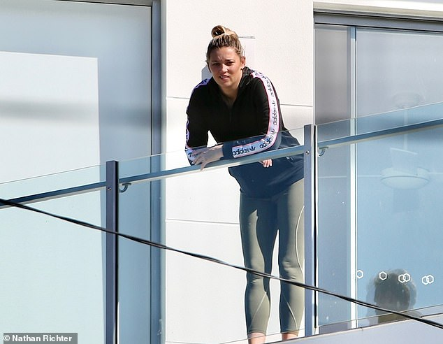 On her own: Karl Stefanovic's wife Jasmine Yarbrough, 36, was seen moving into her new holiday house in Noosa on Monday