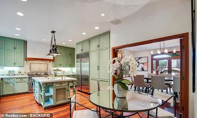 Cosy: A gourmet kitchen is also loaded with high-end stainless appliances and connects to an adjoining breakfast area