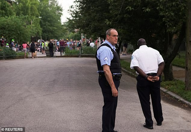 An online petition started over the weekend calling forMayor Krewson to resign has generated more than 40,000 signatures. Pictured: Police officers standing guard during the protest againstMayor Krewson