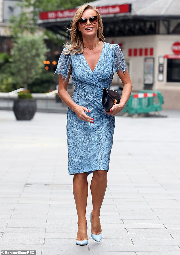 Stylish: Amanda Holden, 49,looked sensational in a figure-hugging blue corded lace dressas she left the studio after presenting her Heart Radio Breakfast Show in London on Monday