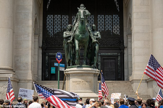 A rally lead by the New York Young Republican Club calls for the Equestrian Statue of Theodore Roosevelt to remain in place on June 28, 2020 in New York City